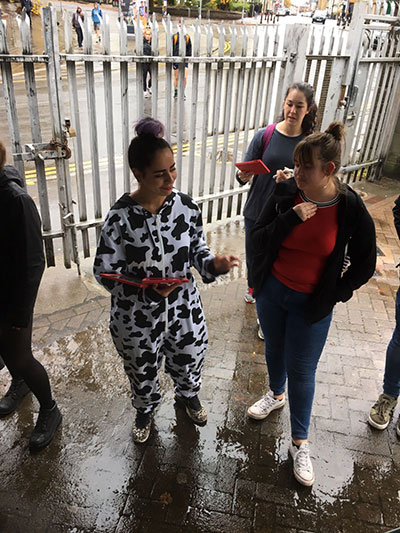 A women in a cow onsie
