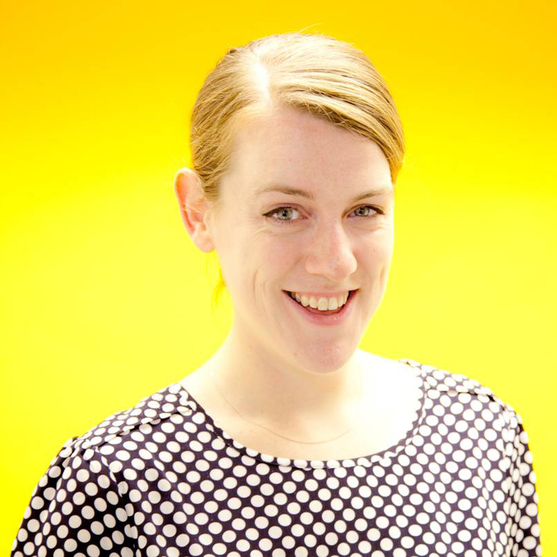 Katharine Hibbert headshot yellow background.jpg